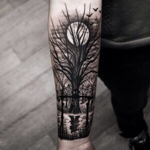 arm tattoo tree and moon