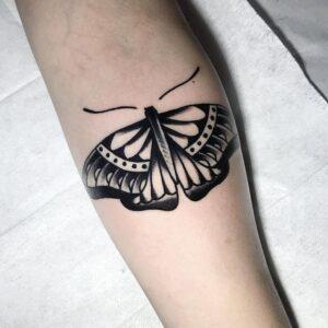 black work butterfly tattoo idea