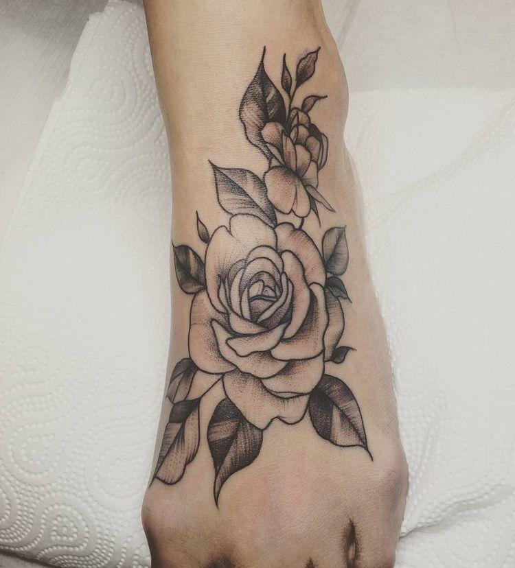flowers foot tattoo