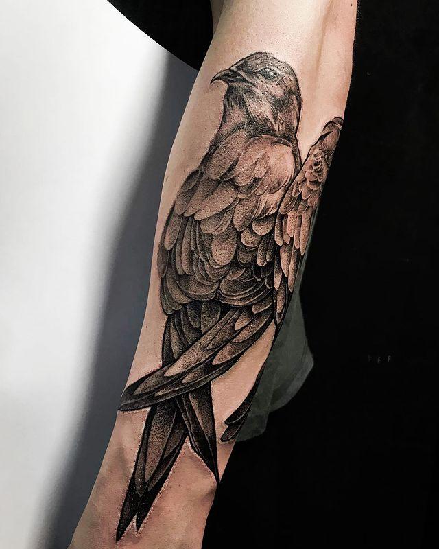 bird tattoo on forearm