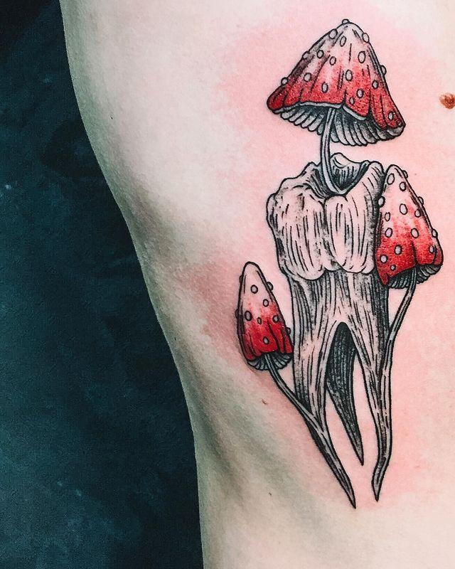 red mushrooms tattoo on rib