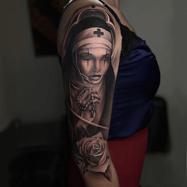 nun tattoo on shoulder