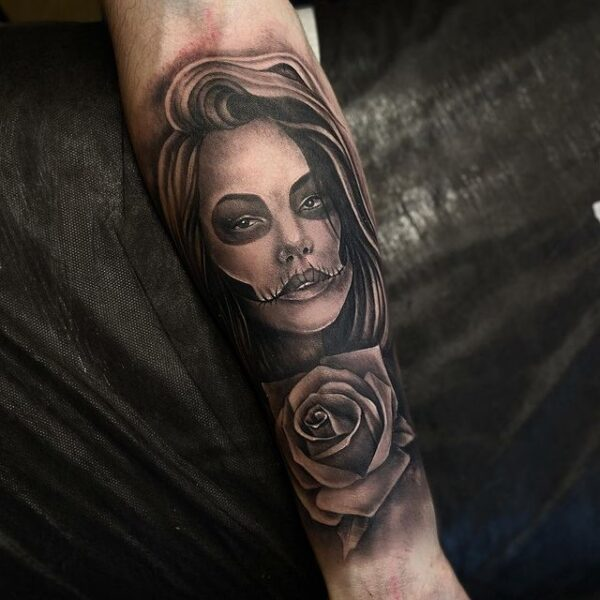 rose and chicano-girl tattoo on forearm