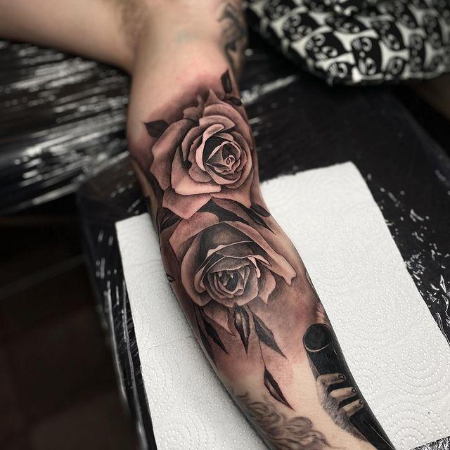 black rose half sleeve tattoo