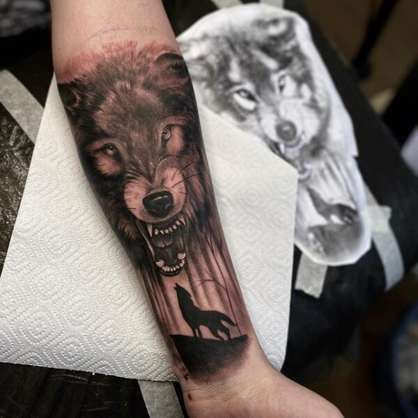 wolf forearm tattoo