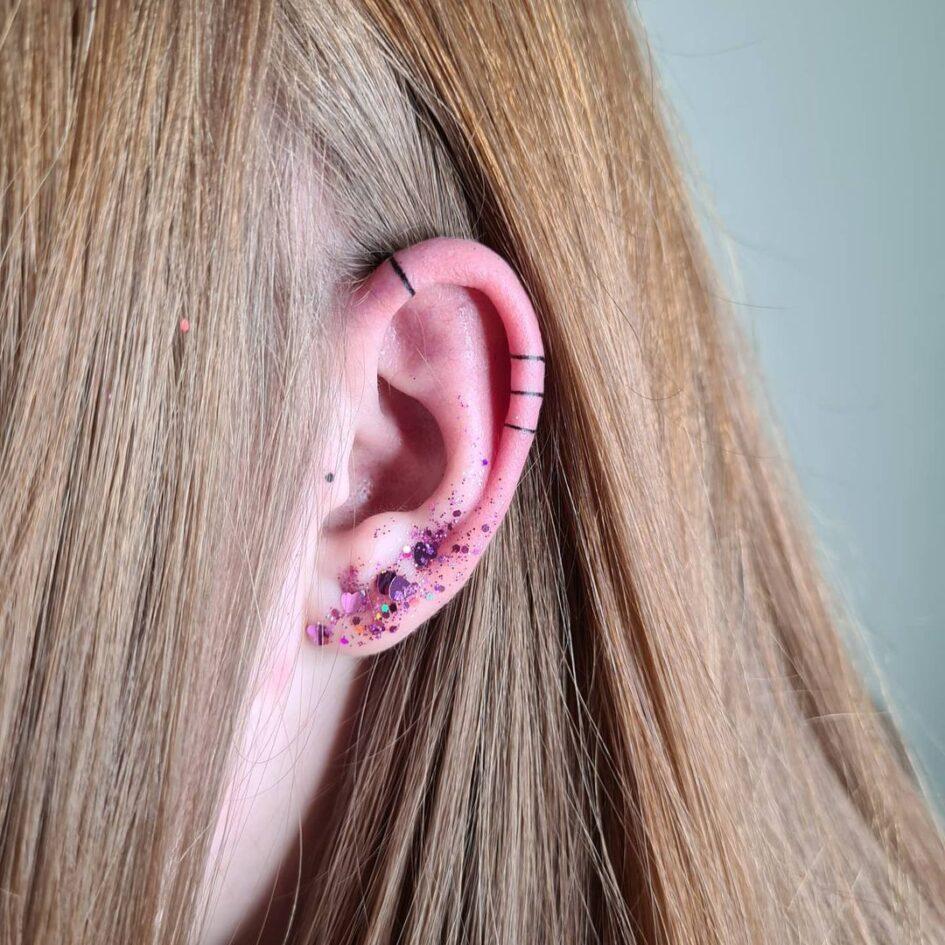 line ear tattoo